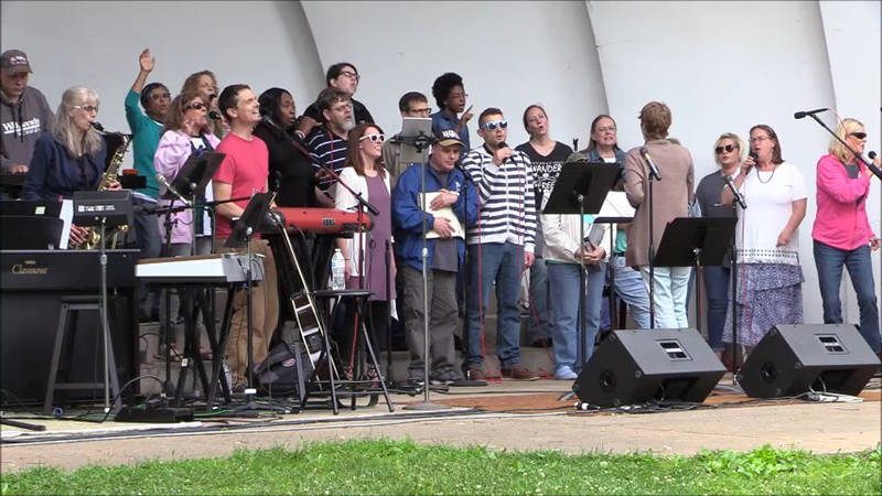 The CollECtive Choirperforms its testimoney day with other churches at Owen Park in Eau Claire Wi.